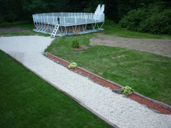 View Remove existing crushed stone walkway and replace with crushed stone walkway in Newton, NH.  Install hemlock bark mulch planter and shrubs files