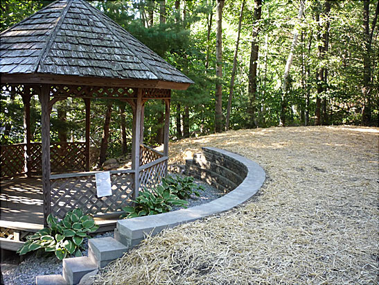 View Excavate and install a Belgard Block retaining wall around a gazeebo in Atkinson, NH.  Grade and Spread loam, seed, fertilize, and straw yard files