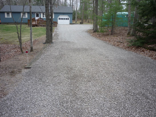 View Crushed stone driveway in Sandown, NH.  Crushed stone graded using skid steer files