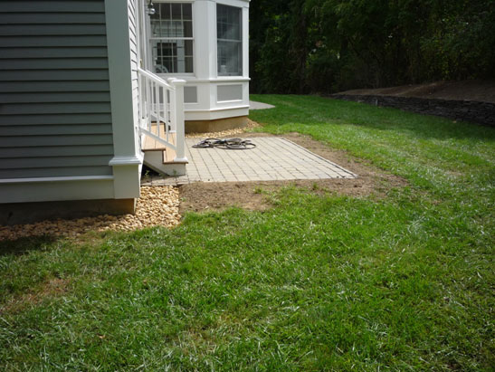 View Excavate, edge, and install Multi-tan stone around a foundation in Newbury, MA files